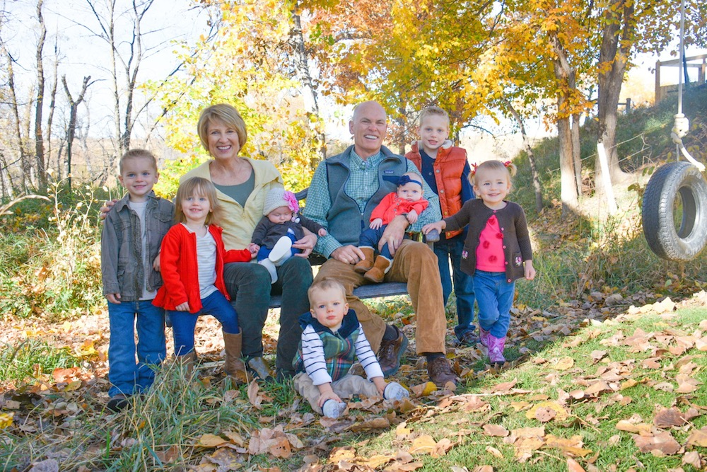 Photo of Terry '74 and Brenda Voth '75 with grandchildren