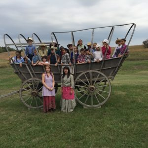 Photo of Vanessa Aguilar at the prairie settlement with the George Stone class.