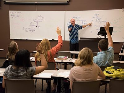 Photo of students participating in class.