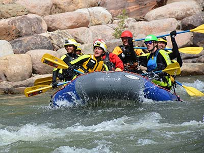 Photo of students in a white water raft.