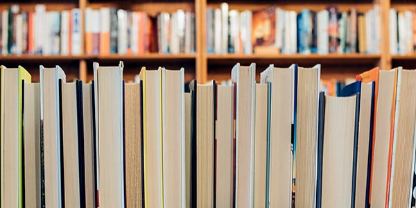 Library books (photo credit goes to Jessica Ruscello of Unsplash)