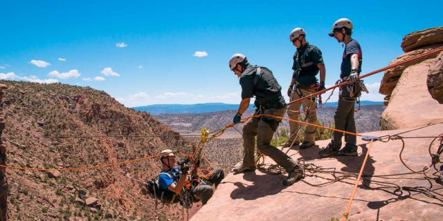 Photo of IRR majors rapelling in Colorado.