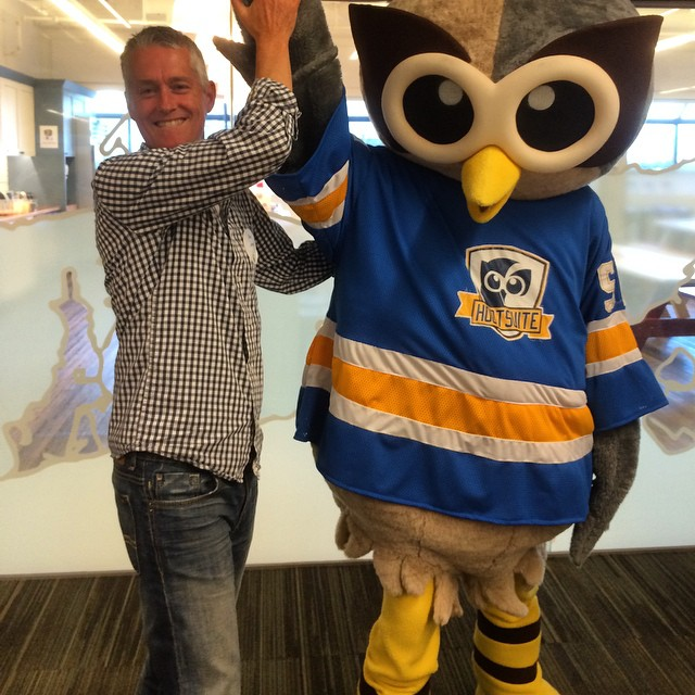 Photo of Steve Johnson with the Hootsuite mascot