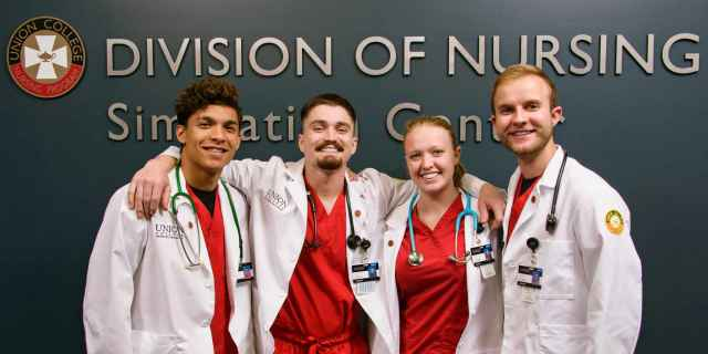 Photo of nursing students in white coats
