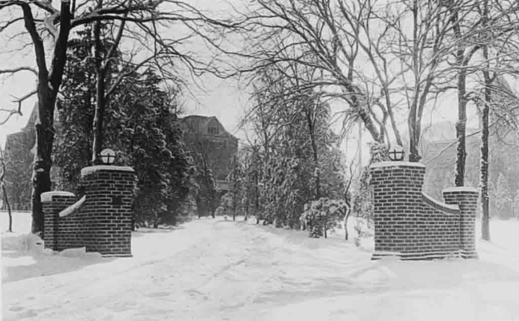 Photo of entrance pillars in the snow.