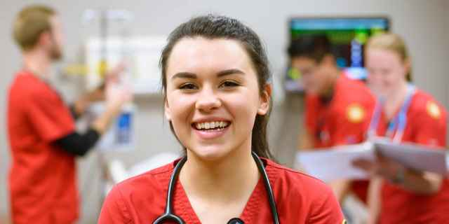 Photo of a nursing student in the simulation lab.