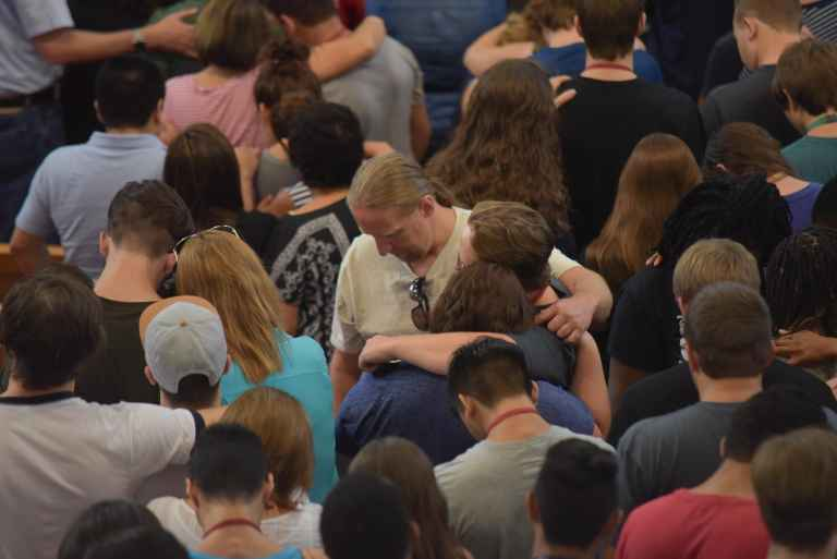 Parents and students share a prayer of blessing at the beginning of each school year.