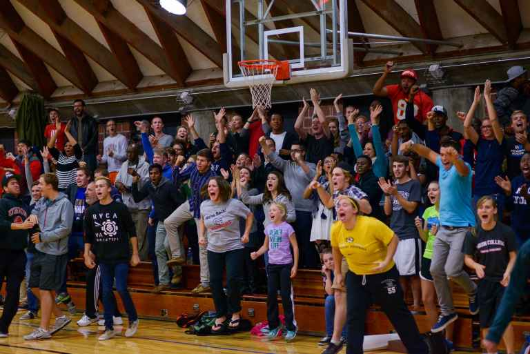 Students and faculty cheer for the Warriors.
