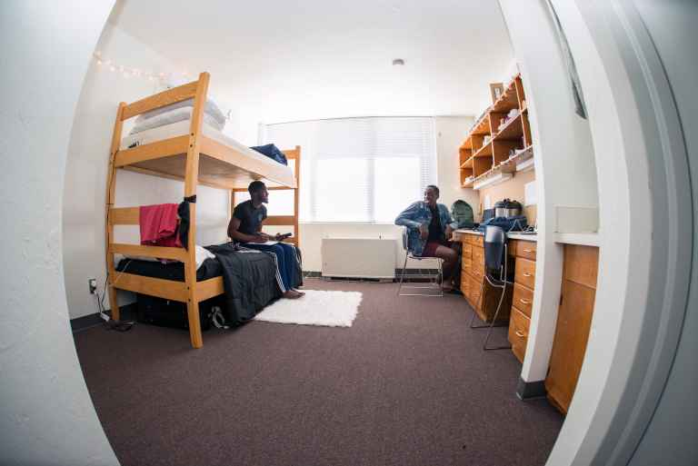 Rooms in Prescott Hall come with built in desks, shelves and drawers as well as in-room sinks and ensuite bathrooms.