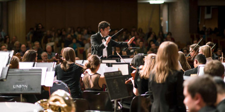 Photo of Dr. Miyashiro directing the Union College orchestra.
