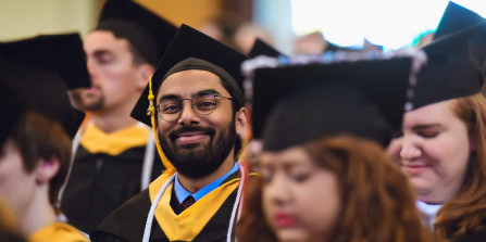 Photo of a student smiling at graduation.
